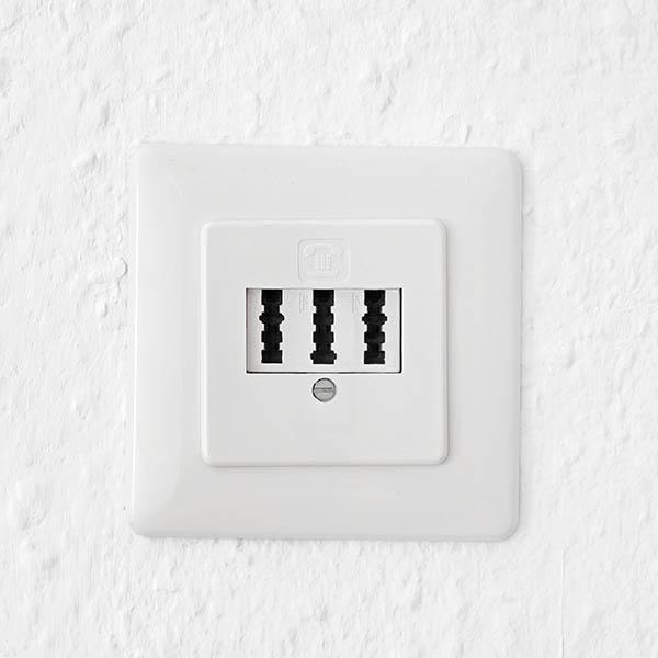 telephone jack / socket on white wall